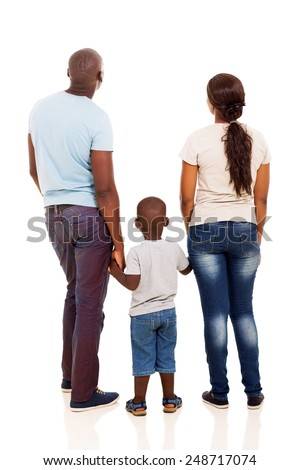 back view of young african family holding hands isolated on white - stock photo