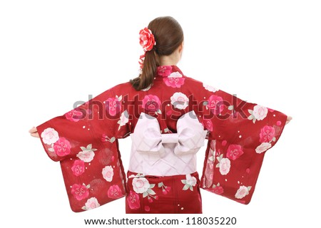 Back view of young asian woman in traditional clothes of kimono - stock photo