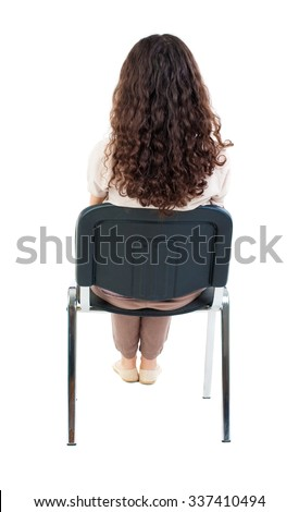 back view of young beautiful  woman sitting on chair.  girl  watching. Rear view people collection.  backside view of person.  Isolated over white background. - stock photo