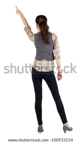 Back view of young brunette woman pointing  . beautiful girl in shirt gesture. Isolated over white background. Rear view. - stock photo