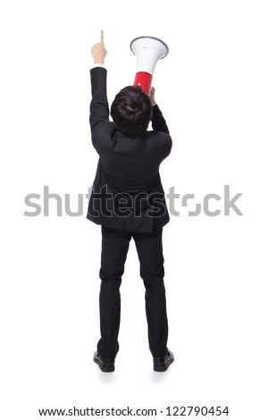 back view of Young business man shouting into a megaphone and finger point to up forward in full length isolated over a white background, asian model - stock photo