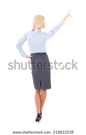 back view of young business woman pointing at something isolated on white background - stock photo