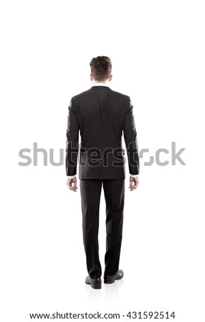 Back view of young businessman in black suit isolated on white background - stock photo