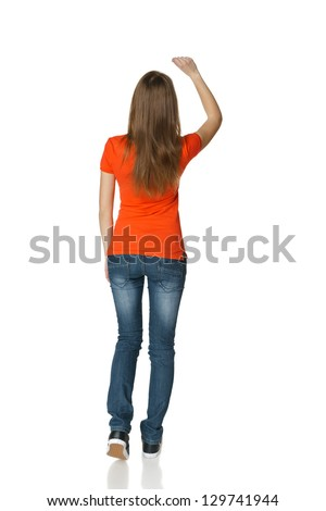 Back view of young casual female in full length writing on the blank copy space, isolated on white - stock photo