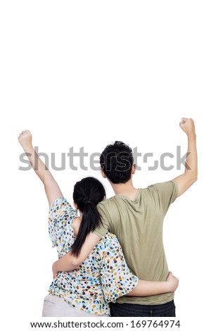 Back view of young couple expressing success. isolated on white background - stock photo