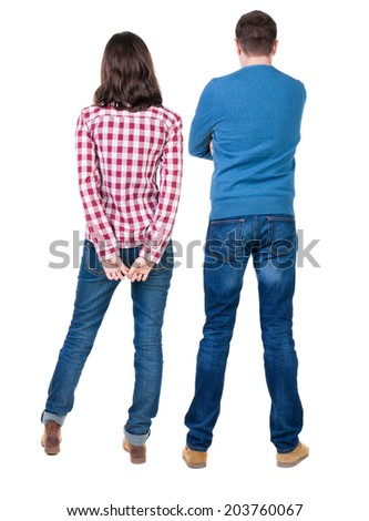 Back view of young couple hug and look into the distance. beautiful friendly girl and guy together. Rear view. Isolated over white background. young woman holds the hand of her husband looking away