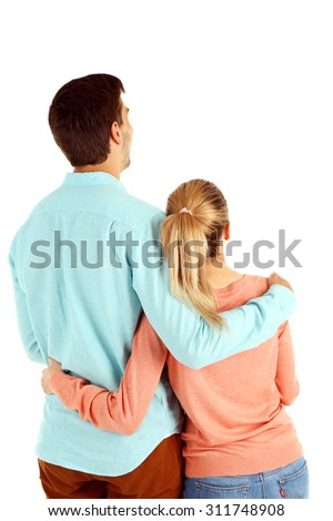 Back view of young couple isolated on white - stock photo