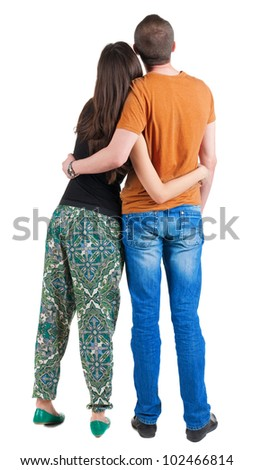 Back view of young couple (man and woman) hug and look into the distance. beautiful friendly girl and guy together. Rear view people collection  backside view of person  Isolated over white background