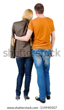 Back view of young couple (man and woman) hug and look into the distance. Rear view people collection.  backside view of person.  Isolated over white background.