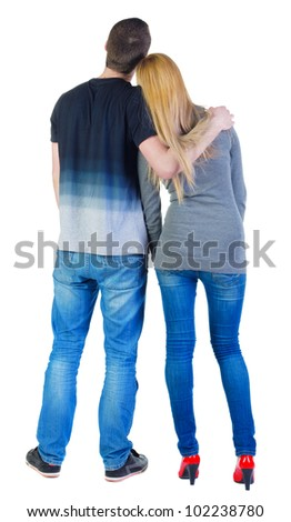 Back view of young couple (man and woman) look into the distance. beautiful friendly girl and guy together. Rear view people collection.  backside view of person.  Isolated over white background.