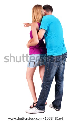 Back view of young couple pointing at wall (woman and man). guy in jeans and girl in dress. looking into distance. Rear view people collection. Backside view of person.  Isolated over white background