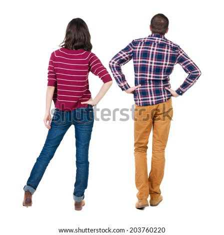 Back view of young couplehug and look into the distance. beautiful friendly girl and guy together. Rear view. Isolated over white background. young woman holds the hand of her husband looking away