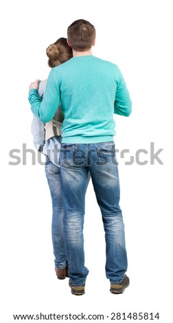Back view of young embracing couple  hug and look into the distance. Rear view people collection.  backside view person.  Isolated over white background. The guy holding the girl behind the shoulders