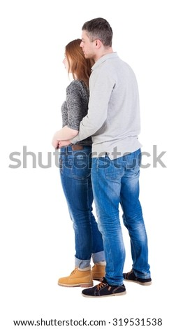 Back view of young embracing couple (man and woman) hug and look into the distance. beautiful friendly girl and guy together. Rear view people collection.  backside view of person.   - stock photo