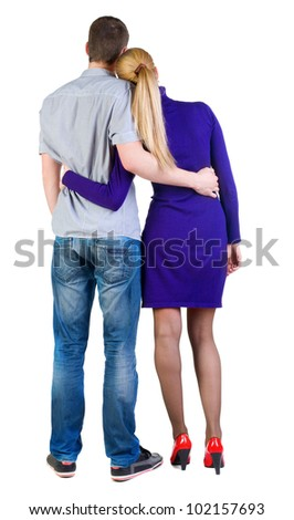Back view of young embracing couple (man and woman) look into distance. beautiful friendly girl and guy together. Rear view people collection.  backside view of person.  Isolated over white background