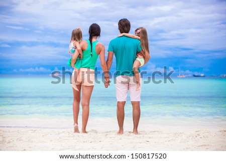 Back view of young family looking to the sea in Philippines - stock photo