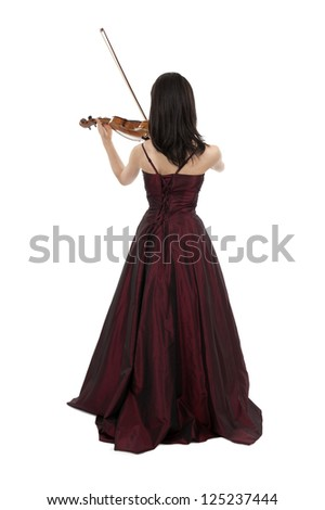 back view of young female violin player - stock photo