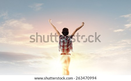 Back view of young girl in casual enjoying music - stock photo