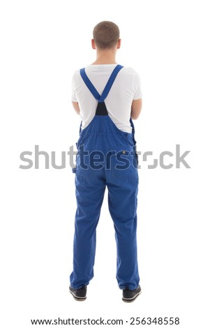back view of young handsome man in blue workwear isolated on white background - stock photo