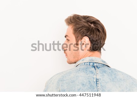 Back view of young handsome man on white background - stock photo