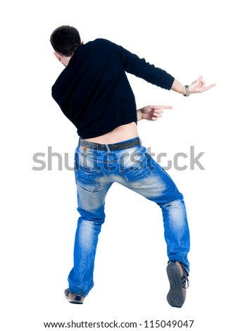 Back view of young man dancing. Rear view. Isolated over white.