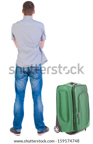 Back view of young man traveling with suitcas. Rear view people collection. backside view of person.  Isolated over white background. - stock photo