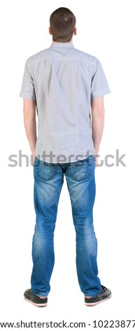 Back view of young men in  shirt and jeans.  Guy  looks away. Rear view people collection.  backside view of person.  Isolated over white background. - stock photo