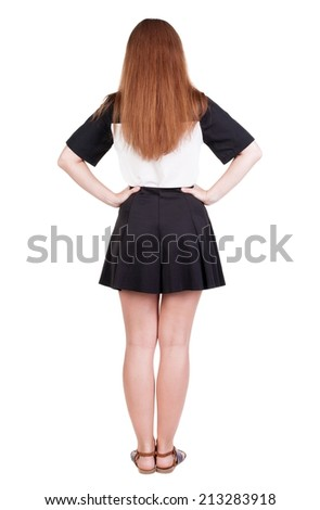 Back view of young redhead woman pointing at wall. beautiful girl in dress. Rear view people collection. backside view of person. Isolated over white background. - stock photo