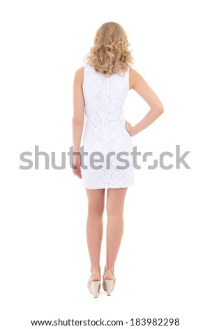 back view of young woman in white dress isolated on white background - stock photo