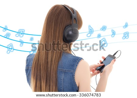 back view of young woman listening music with mobile phone over white background
