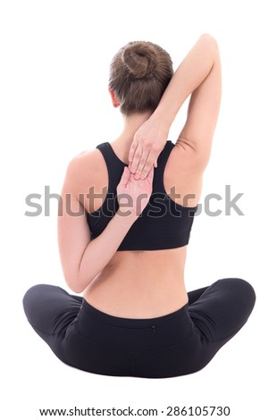 back view of young woman sitting in yoga pose isolated on white background