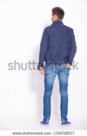 back view picture of a casual man with one hand in his pocket