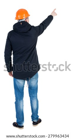 Back view pointing young men in parka and helmet. Young guy  gesture. Rear view people collection.  backside view of person.  Isolated over white background. Young engineer supervises construction.  - stock photo