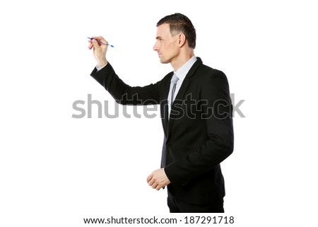 Back view portrait of a businessman writes with pen at copyspace over white background