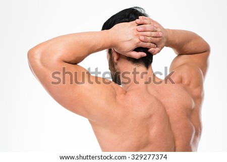 Back view portrait of a man with muscular body standing isolated on a white background - stock photo