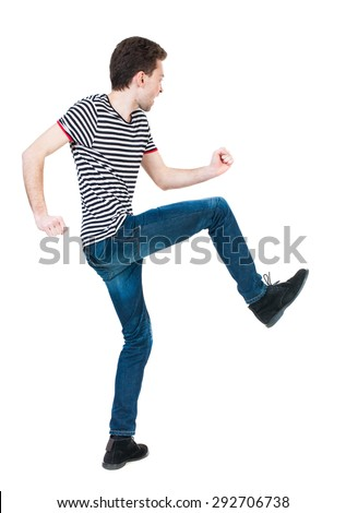 back view skinny guy funny fights waving his arms and legs. Isolated over white background. Rear view people collection. backside view person. Funny guy clumsily boxing. guy in shirt fights feet - stock photo