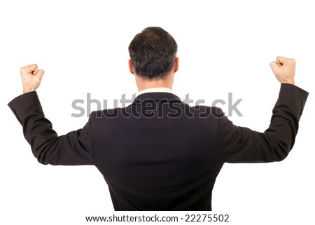 back view victorious businessman raising arms
