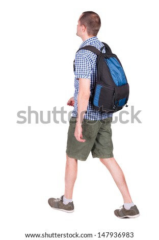 back view walking man with backpack.  brunette guy in motion. backside view of person.  Rear view people collection. Isolated over white background. young man goes to side travel bag on wheels
