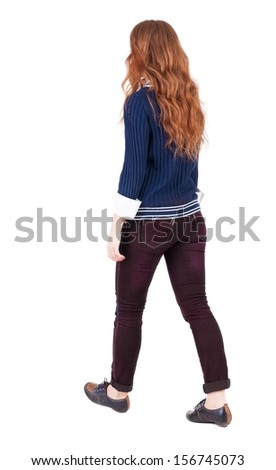 back view walking woman. beautiful redhead girl in motion. backside view person.  Rear view people collection. Isolated over white background. A girl in blue sweater and white shirt is moving forward