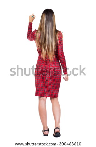 back view writing beautiful woman. Young girl in dress. Rear view people collection.  backside view person. Isolated over white background.  Long-haired girl in a red plaid dress draws a felt-tip pen. - stock photo
