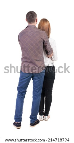 Back view young embracing couple (man and woman) hug and look into distance. beautiful friendly girl and guy together. Rear view people collection. backside view person. Isolated over white background - stock photo