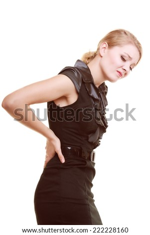 Backache. Young businesswoman woman blonde girl suffering from back pain isolated on white. - stock photo