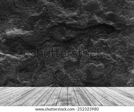 Backdrop black sandstone wall and wood slabs arranged in perspective texture background in black and white. - stock photo