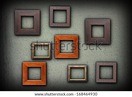 backdrop for your pictures design, large number of colorful wood frames on green wall - stock photo