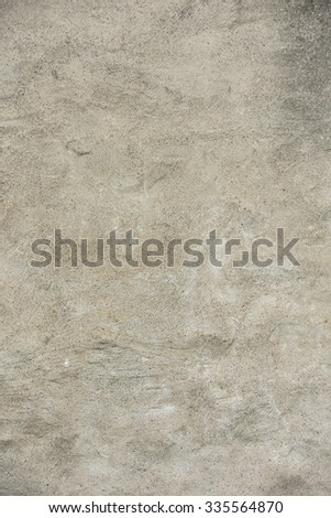 Backdrop of an old and weathered stone wall. With a worn grunge atmosphere this architectural detail gives the tone and feeling of a rough and old building. - stock photo