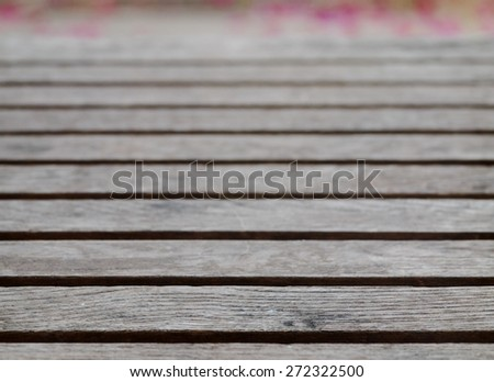 backdrop or background picture of old aged weathered cracked naked gray brown abandoned wood profile surface texture close up outdoor - stock photo