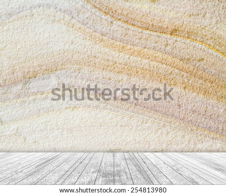 Backdrop sandstone wall and wood slabs arranged in perspective texture background. - stock photo
