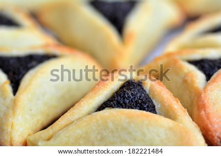 Backed Hamentashen, Ozen Haman, Purim cookies for the Jewish holiday Purim. - stock photo