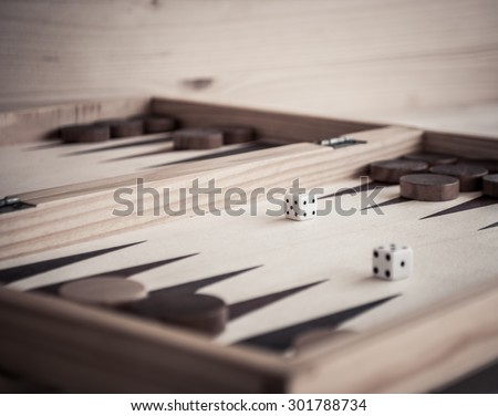 Backgammon and dices - stock photo
