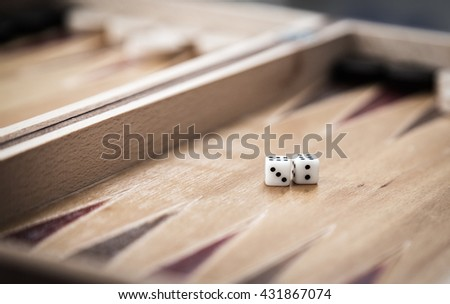 Backgammon and dices. - stock photo